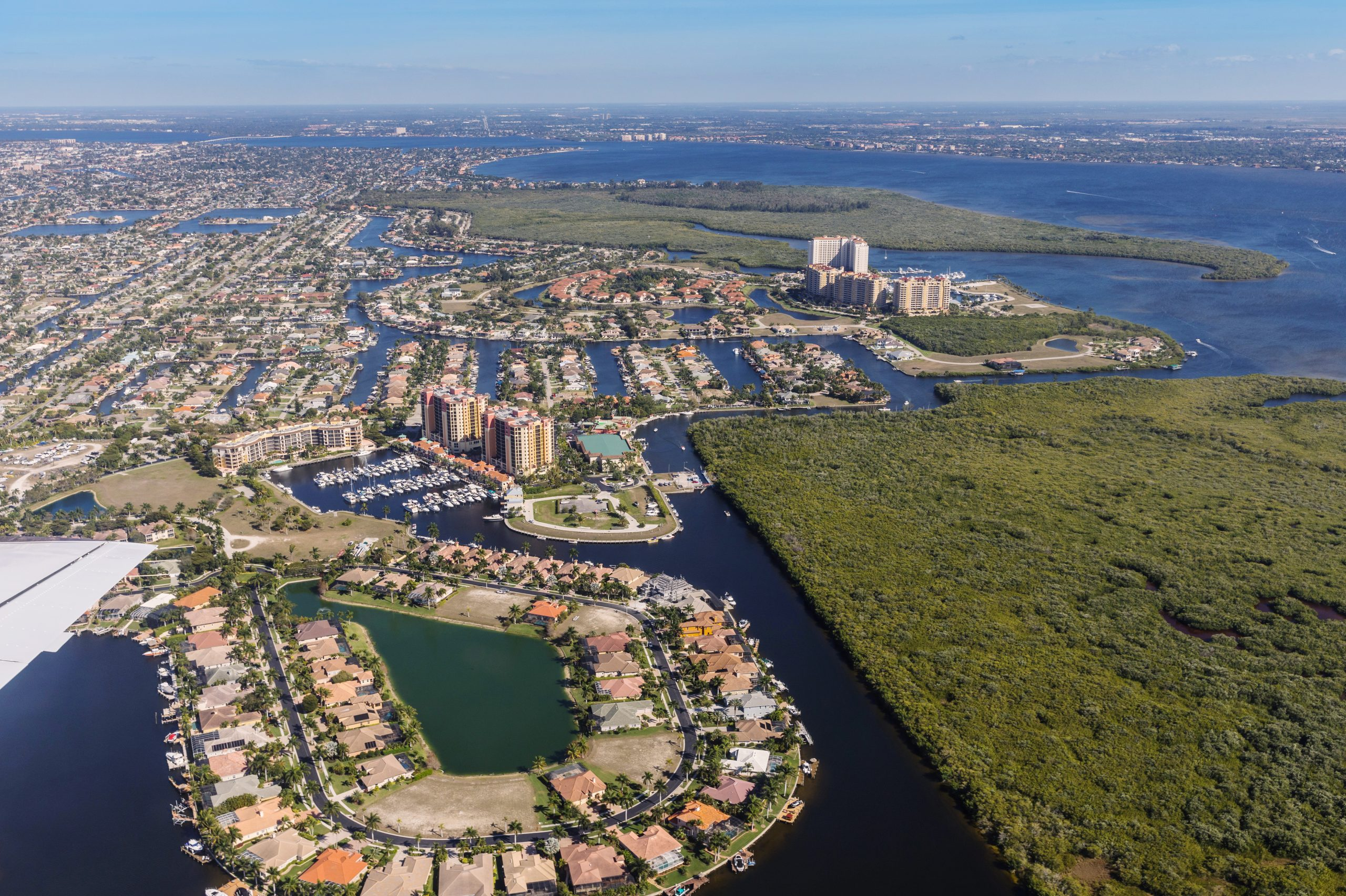 Aerial view of city and gulf Cape Coral, Florida. The Westin Cape Coral Resort at Marina Village